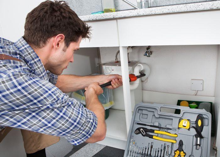 plumber fixing kitchen